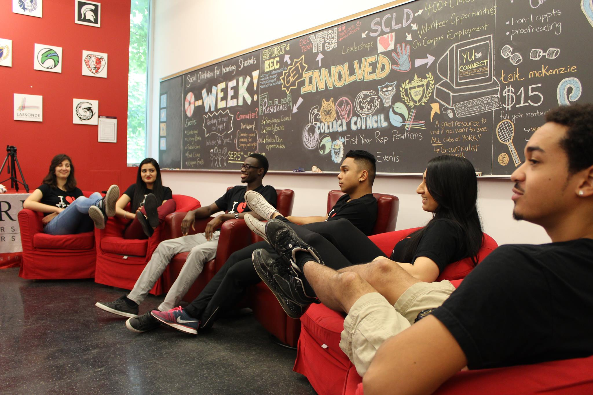 Members of the RED Zone hold a team meeting in a classroom at York University.